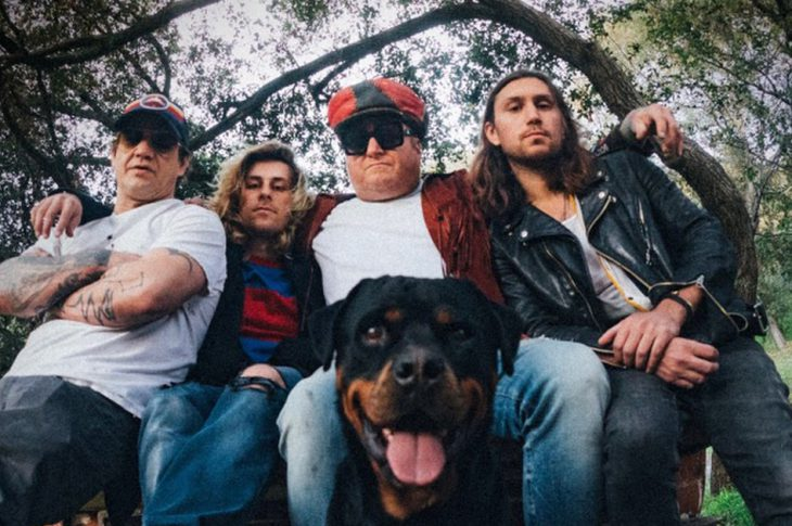 band photo of members of Spray Allen with dog.