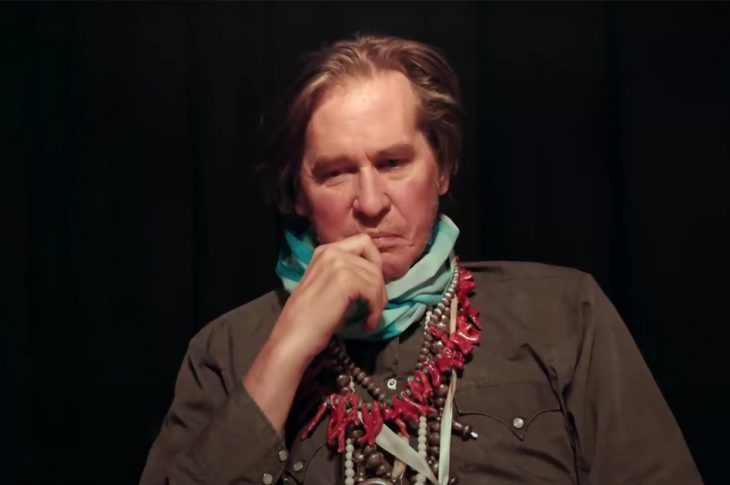 photo of modern-day Val Kilmer sitting with a contemplative look on his face.