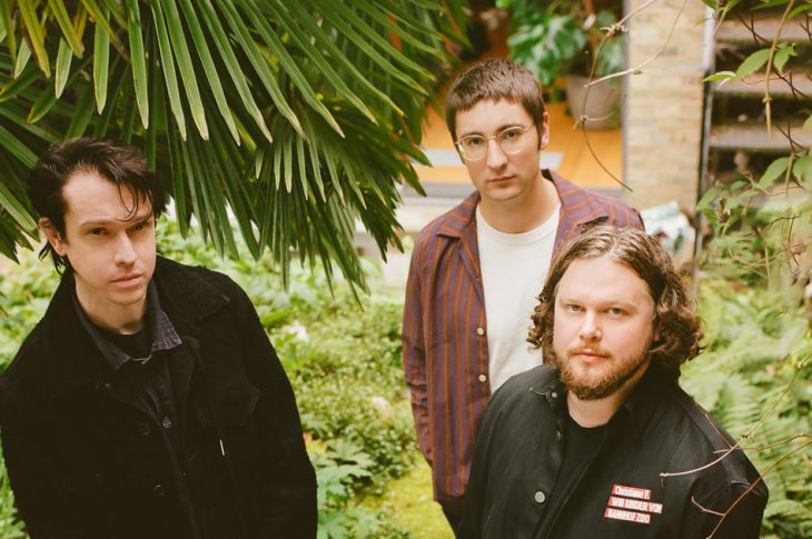 Photo of Alt-J band members outside by Rosie Matheson